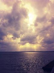 Light Breaking Through (jayRaz) Tags: light orange sun sunlight lake clouds day waves purple cloudy sunny ripples rays rockwall raysoflight iphone partlycloudy lakerayhubbard