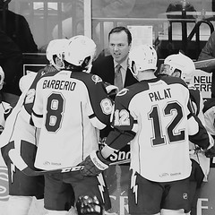 Sports Intensity (Scottwdw) Tags: blackandwhite newyork reflection men sports glass monochrome coach nikon tampabay icehockey rochester professional pro syracuse americans ahl lightning players warmemorial crunch journalism intensity overtime amerks joncooper americanhockeyleague afsvrzoomnikkor70200mmf28gifed onondagacounty d700 scottthomasphotography