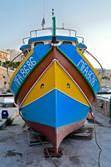 Look me in the eyes (jeremyhughes) Tags: boat outdoor malta stpaulsbay sanpawlilbaar nautical fishingboat bow bows eye eyes colourful colorful color colour endon front symmetry symmetrical fishing nikon d750 35mm nikkor 35mmf2d harbour port beached
