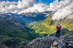 Capturing the moment (Richard Larssen) Tags: richard richardlarssen larssen landscape dalsnibba geiranger clouds norway norge norwegen nature girl woman mountain tree teamsony tourism sky scenery scandinavia scenic stranda mre romsdal sony sonyalpha alpha sel1635z a7ii