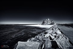 Nobbys Head. (Bill Thoo) Tags: explore nobbyshead newcastle nsw australia beach coast breakwater ocean sea pacificocean pacific harbour lighthouse landscape monochrome blackandwhite sony a7rii samyang 14mm ngc