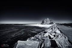 Nobbys Head. (Bill Thoo) Tags: nobbyshead newcastle nsw australia beach coast breakwater ocean sea pacificocean pacific harbour lighthouse landscape monochrome blackandwhite sony a7rii samyang 14mm ngc