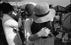 Scene with friendship (Helsinki Drifter) Tags: streetphotogrraphy blackandwhite film urban snapshot people interaction hugging socialdocumentary helsinki citycentre filmphotography traditional tones greys ilford panf