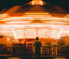 Sometime you may stop but life carries on (dananguyen) Tags: houston texas carousel merrygoaround carnival fair nightshot longexposure lights canont3i canon