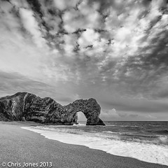 Durdle Door Winter Black & White. (Chris Jones www.chrisjonesphotographer.uk) Tags: world ocean door morning chris winter sea england sky blackandwhite bw sun white seascape black west heritage beach rock clouds landscape jones early blackwhite site am exposure arch hole empty south dramatic wave unesco formation lee dorset limestone filters effect breaking durdle