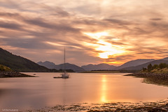 Sunset in Ballachulish, Scottish Highlands (slize12) Tags: uk longexposure greatbritain sunset sky sun mountain water bay scotland boat highlands unitedkingdom september 2012 ballachulish scottishhighlands a82