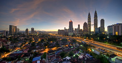 Kuala Lumpur Sunrise Panorama [EXPLORED] (TOREX PHOTOGRAPHY) Tags: sky urban panorama clouds sunrise buildings lights landscapes town nikon cityscape explore malaysia getty kualalumpur 1020mm hdr klcc gettyimages twintower cahaya bandar kampungbaru d90 petronastwintower sigmalenses torex