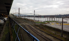 nw13b01 New Westminster Tracks & Fraser River Bridges (CanadaGood) Tags: britishcolumbia bc newwestminster river fraserriver bridge pattullobridge railway track parking 2013 canadagood colour color green morning canada thisdecade railroad