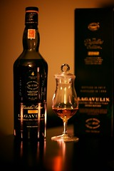 Lagavulin (generalstussner) Tags: birthday reflection glass canon table golden scotland cozy bottle warm candles candle dof bokeh scottish islay whisky scotch shallow smoky fullframe celebrate isla celebrating singlemalt f12 lagavulin distillersedition 16yo canonef85mmf12liiusm 5dmarkiii nosingglass lagavulindistillersedition