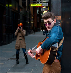 Tuned up ... (Charles Hamilton Photography) Tags: street portrait 35mm dof guitar glasgow streetportrait buchananstreet depthoffield busker busking citycentre mitchelllane nikond90 streepphotography glasgowstreetphotography