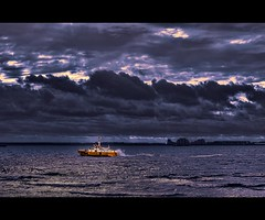 In a calm sea every man is a pilot (Wim Koopman) Tags: city sea seascape holland reflection building netherlands dutch weather yellow clouds dark landscape photography boat photo nikon ship view purple cloudy horizon stock nederland dramatic wave stormy pilot vlissingen appartment stockphoto flushing stockphotography d90 wpk ierseke seapilots