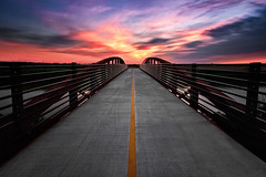 I Walk the Line (boingyman.) Tags: park longexposure bridge sunset canon canal crossing line neighborhood sacramento 1022 natomas 10stop nd110 t2i boingyman