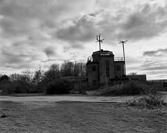 Greenham Common Neg Scan Control Tower (Rebecca Sharplin Hughes) Tags: film:iso=400 developer:brand=agfa film:brand=rollei agfar09oneshot developer:name=agfar09oneshot rolleiinfraredir film:name=rolleiinfraredir400 filmdev:recipe=8414 rebeccasharplinhughesmarchportfolio