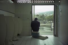 gentle man (Tom Kondrat) Tags: street man film 35mm sitting view taiwan toilet taipei analogue olympusmjuzoom105