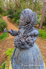 Elizabethan Statue (Dan Waters Photography) Tags: travel flowers red vacation sculpture plants usa plant flower green statue gardens bronze garden island coast early nc memorial azaleas south north northcarolina landmark tourist historic queen east southern roanoke american carolina historical azalea outer elizabethan banks touristattraction publicgardens obx eastcoast queenelizabeth manteo formalgardens roanokeisland elizabethangardens queenelizabeth1 outerbanksphotos pictureoftheouterbanks theelizabethangardens outerbanksphotography obxphotography