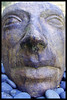 Stoneface (TheMightyEye) Tags: art face garden nose carved artwork eyes outdoor pebbles lips statuary gardenart gardenstatuary bluepebbles themightyeye