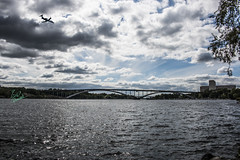 Took two different photos of the bridge and the plane from almost the same position and combined the two using Photoshop. (izzetq) Tags: sky stockholm plane bridge buildings architecture water sea boat clouds canon photography photographer