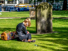 Peaceful place for a call ... (Mayur Shivz - Out and about casual photography) Tags: cathedral cemetery church girl mobile phone call talk peaceful atmosphere green sun shine candid capture panasonic lumix g6 olympus 45mm f18