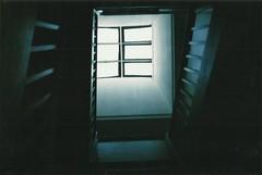 Light in the dark (desmond.hogan) Tags: olympustrip35 35mm dark light grain indoors hope liverpool uk