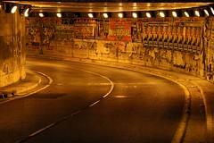 Tunnel (Daniel Nebreda Lucea) Tags: tunnel tunel city ciudad night noche light luz urban urbano curve curva architecture arquitectura travel viajar canon zaragoza pavement pavimento road carretera car coche shadow sombra street calle old viejo details detalles