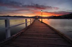 Putting Out Fire (Sanjeev Deo) Tags: akaroa new zealand nz pier sea ocean canterbury christchurch sunset light landscape