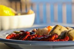 Appetizers (castier) Tags: artichaud artichoke bleu blue cinqueterre citron italie jaune lemon olive red riomaggiore rouge tomate tomato yellow dof nourriture