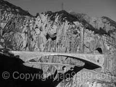 REU240 Devil's Bridges over the Reuss River, Schllenen Gorge, Andermatt, Uri, Switzerland (jag9889) Tags: 2016 20160823 alpine andermatt archbridge bw blackandwhite bridge bridges brcke ch cantonofuri centralswitzerland crossing devil devilsbridge europe flickr gorge gotthardstrasse helvetia infrastructure innerschweiz kantonuri monochrome outdoor pont ponte puente reuss river roadbridge schlucht schweiz schllenen schllenenschlucht stone suisse suiza suizra svizzera swiss switzerland teufel teufelsbrcke uri zentralschweiz jag9889