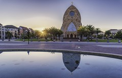 Sunrise and Oratory (JWY80) Tags: 24120mm avemaria avemariauniversity colliercounty d750 florida nikkor nikon oratory chiesa church kirche palmtrees reflection sculpture starburst sunrays sunrise glise unitedstates us