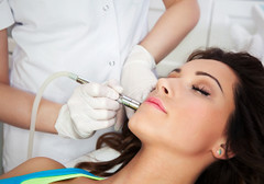 Woman getting laser face treatment in medical spa center, skin rejuvenation concept (Qcumberz) Tags: acne aging apparatus beautician beautiful beauty blemish care cell clinic cosmetic cosmetology dermabrasion dermatology device exfoliation face facial health healthy improves increase laser lift lifting medical medicine microdermabrasion moisture moisturizing professional reduce regeneration rejuvenation removal removing resurfacing scar skin skincare spa spots technology therapy tone tool treatment woman wrinkles young