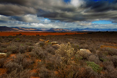 Treasure Hunting (Jurjen Harmsma Photography) Tags: africa red sun mountains travelling colors clouds southafrica dessert photography landscapes high travels rocks day skies cloudy dry hills views outback layers tones sceneries 2011 airscapes jurjenharmsma