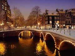 A beautiful wintry evening in centre of Amsterdam (Bn) Tags: world street trees windows winter light sunset people house snow cold holland heritage church water netherlands dutch amsterdam weather bike night corner walking frank anne boat canal cozy cool topf50 colorful jan snowy walk bikes atmosphere scooter file canals unesco romantic prinsengracht snowfall topf100 mokum rembrandt topf200 gezellig cafs keizersgracht jordaan leliegracht westertoren pakhuis lange westerkerk wester celcius grachtengordel rondvaartboot 1000km 100faves 50faves 200faves grachtengordelwest