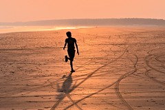 SEA.....SAND......SUNSET.....SHADOW [Explored] (pallab seth) Tags: travel boy sunset shadow sea india tourism silhouette kids children landscape kid sand child candid joy youngster bengal digha explored udaypur pallabseth