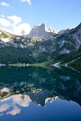 mountain symmetry (marin.tomic) Tags: travel blue summer sky cloud mountain lake alps reflection nature water berg austria mirror see sterreich nikon tranqulity calm symmetry alpine shore alpen dachstein obersterreich austrian gosau d90 gosausee