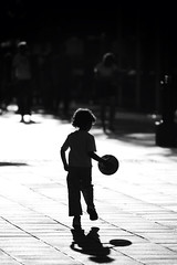 Play ball (lukemarkof) Tags: city light boy sunset shadow summer bw sun sunlight black game building art kids backlight canon ball dark hair exposure child play view outdoor australia melbourne special interest challenging bouncing 2013 60d canon70200f28lll