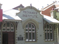 The Former Leongatha Mechanics' Institute and Free Library - McCartin Street, Leongatha (raaen99) Tags: building brick window architecture facade awning town education iron pattern exterior architecturaldetail queenanne library cement decoration australia stainedglass victoria institute publicbuilding artnouveau 1912 canopy 20thcentury markettown stainedglasswindow edwardian federation publiclibrary 1900s 1911 jugendstil gippsland artsandcraftsmovement artsandcrafts countryvictoria stylised mechanicsinstitute civicbuilding belleepoque adulteducation twentiethcentury bellepoque southgippsland architecturalfeature artscraftsmovement cementbrick freepubliclibrary leongatha queenannearchitecture ironcanopy artsandcraftsstyle artscraftsstyle provincialvictoria educationalestablishment federationqueenanne dairytown federationqueenannearchitecture artnouveaustainedglass architecturallydesigned technicalinstitution artnouveaustainedglasswindow leongathamechanicsinstitute leongathafreepubliclibrary mccartinstreet mccartinst hvandachampion loringandspeers billardsaloon billairdhall leongathabilliardsaloon leongathabilliardhall