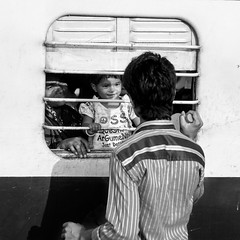 Arguments (streetwrk.com) Tags: street people bw india window monochrome train blackwhite streetphotography stranger trainstation socialdocumentary streetogs streetwrk
