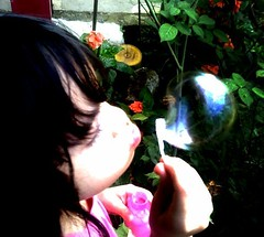 My niece, captured with my camera when blowing a bubble. (RevloyReiyel) Tags: col