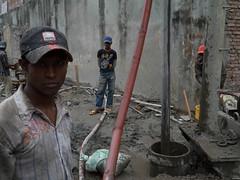 Old Dhaka (TEConstantine) Tags: old workmen baseball caps cement dhaka piling bangladesh drilling groundworks