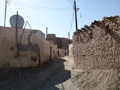 Abandoned mud brick village behind Bait Al Marah castle (John Steedman) Tags: castle oman muscat  sultanateofoman       baitalmarah