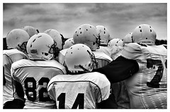 The Mean Machine (Beeches Photography) Tags: blackandwhite bw game cold football team sunday watching player american players guildford winning americanfootball anxious anygivensunday footballer meanmachine sundayfootball collagefootball uploaded:by=flickrmobile flickriosapp:filter=panda pandafilter brunelburners