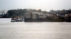 File0253 (alternate_world) Tags: usa skyline boats fishing louisiana ships neworleans cranes swamps mississippiriver houseboats alligators barges paddlewheel riverlife drydocks southlouisiana