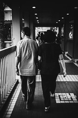 hold 2 (buckyishungry) Tags: bridge love walking march hands singapore couple fuji steps together elderly walkway finepix older holdinghands behind grip intimate overhead hold orchardroad fareastplaza x100 2013 humansofsingapore