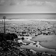 (Jo Duggan) Tags: uk sea bw white black beach monochrome wales square nikon pembrokeshire amroth bsquare d300s