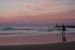 Last Light (haddartist) Tags: ocean winter sunset sky cold reflection beach colors sign clouds evening rocks colorful surf waves break dusk surfer jetty wave surfing calm oceanside surfboard marker virginiabeach wetsuit lineup oceanfront beachbreak 1ststreet