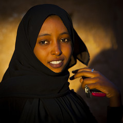 Young Sudanese Woman, Kassala, Sudan (Eric Lafforgue) Tags: africa sunset portrait woman beauty smile face vertical outdoors photography day veiled veil northafrica soedan sudan arab mobilephone oneperson soudan saharadesert northernafrica realpeople traveldestinations colorimage onewomanonly lookingatcamera headandshoulder  1people kassala szudn sudo  northernsudan northsudan      xuan ert8228
