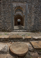 Old Mosque In Kilwa Kisiwani, Tanzania (Eric Lafforgue) Tags: voyage africa travel history coral rock vertical stone architecture tanzania photography ruins photographie pierre muslim islam faith religion ruin nopeople mosque historic unescoworldheritagesite ruine foi cult histoire mosquee archeology ablution swahili afrique ruines archeologie historique eastafrica mihrab musulman tanzanie coralstone culte colorpicture placeofinterest photocouleur afriquedelest enhauteur kilwakisiwani colourpicture lindiregion 9989tanzania