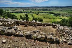 Embedded earthenware dolia (storage jars) at the Oppidum d'Ensrune in southern France (mharrsch) Tags: archaeology archaeologicalsite enserune france oppidum hillfort celt roman ancient fort fortification languedoc mharrsch