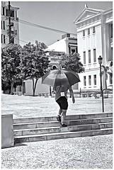 Hombre, Escalera y Sombrilla (Man, Stairs & Umbrella) (Samy Collazo) Tags: canonlvsb1952leicacopy industar2250mmf35 kodaktrix400 sombrilla umbrella streetphotography fotografiacallejera sanjuan oldsanjuan viejosanjuan puertorico bn bw