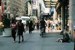Kneeling (Jose Miguel Moreno Rahn) Tags: homeless new york kneeling love people passing by bum rich poor skyline