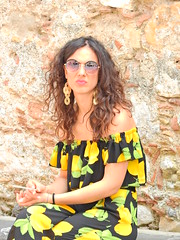 Limoncello (Couldn't Call It Unexpected) Tags: taormina sicily italy lady woman candid lemons cigarette smoking lips sunglasses earrings